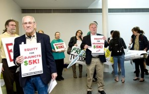 Retired SUNY New Paltz German Professor Peter Brown (left) and administrator Richard Kelder (right) stand outside and protest with fellow faculty members and students infront of the room before a faculty meeting was held. SUNY Chancellor Nancy Zimpher took time to answer questions during the meeting at the SUNY New Paltz campus in New Paltz on Thursday, May 9, 2013. Photo By: Kelly Marsh for the Times Herald-Record