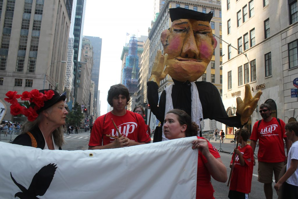 Amy Trompetter, the maker of the Mother Jones puppet, along with NP student Nolan